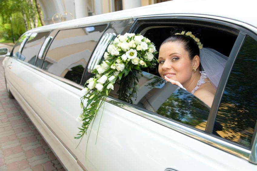 decorated white stretch wedding limo